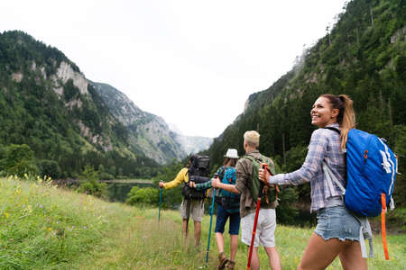 Group of happy hiker friends trekking as part of healthy lifestyle outdoors activity 版權商用圖片 - 157342001