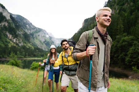 Group of friends on a hiking, camping trip in the mountains