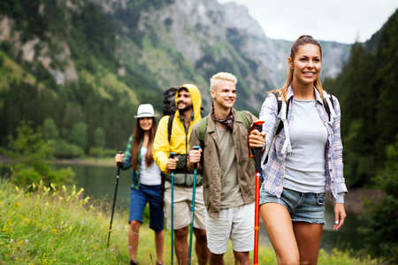 Group of happy hiker friends trekking as part of healthy lifestyle outdoors activity 版權商用圖片 - 157341658