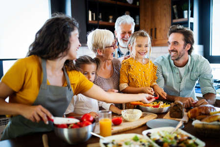 Happy family spending quality time together in the kichen Stock Photo