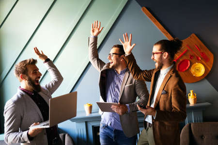 Happy successful business man giving a high fives gesture as cheer their success 版權商用圖片