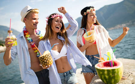 Summer, vacation, party, people concept. Group of friends having fun and party on the beach.