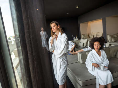 Happy young people enjoying wellness spa resort treatments