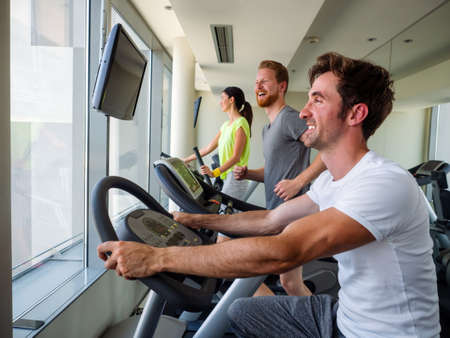 Fitness, sport, training, gym and lifestyle concept. Group of people working out in gym