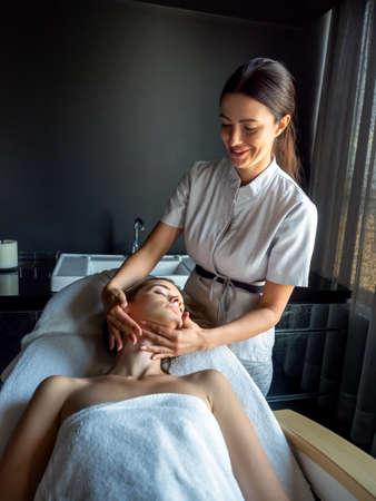Beautiful woman getting a face treatment at beauty salon.