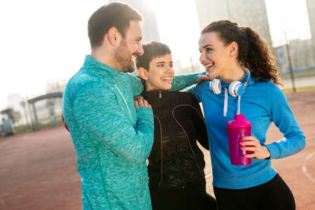 Happy people enjoying friend time at jogging outdoor. Sport people healthy lifesytle concept