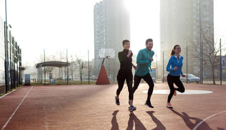 Group of sports friends people are training outdoors