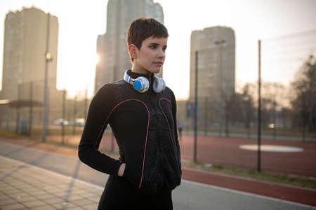 Portrait of fit woman taking break from jogging