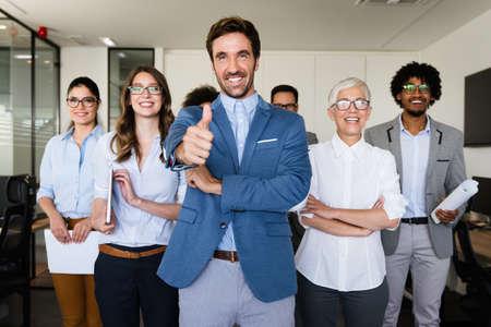 Happy business people celebrating success at company 版權商用圖片
