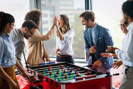 Excited diverse employees enjoying funny activity at work break, creative friendly workers play game 版權商用圖片