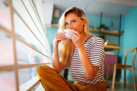 woman enjoys fresh coffee in the morning at home lifestyle