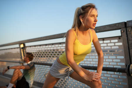 Happy young woman exercising outdoors. Living healthy life