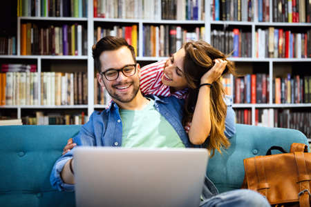 Couple in love spendig fun time together. Reading, work, study, happiness concept 版權商用圖片