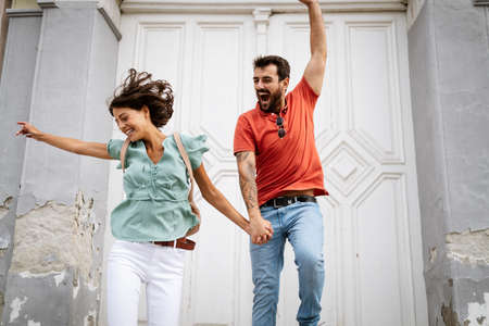 Happy young loving couple having fun and jumping outdoors Stockfoto