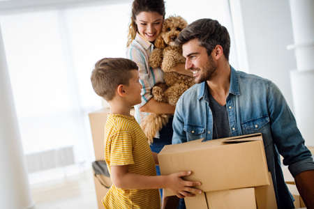 Husband and wife and their son with pet moving in new home.
