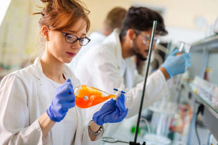 Group of medical scientists working at laboratory. Science, chemistry, medicine and people concept