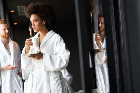 Woman in bathrobes enjoying tea during wellness weekend