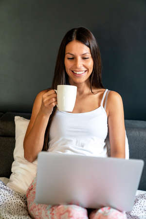 Freelancer, business woman working with laptop from home.