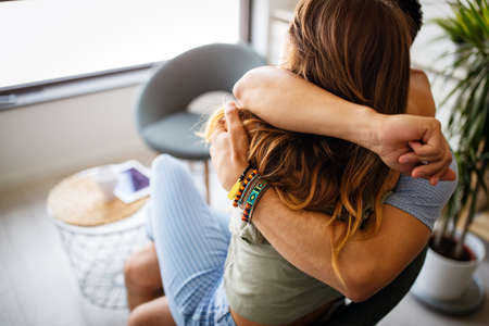 Romantic happy young couple relax at home, have fun and hugging