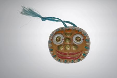 meant: Korean mask ornament meant to depict intensity, apprehension