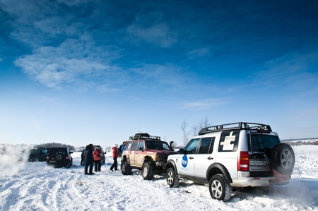 SUVs: Land Rover Discovery and Nissan Patrol Car on background the Russian winter. February 19, 2011