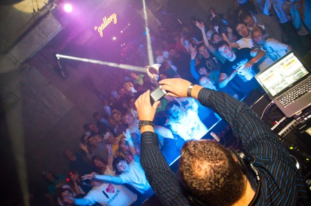 DJ M.I.K.E shoots video on mobile phone.  Concert Gaudi club in Moscow. October 16, 2010
