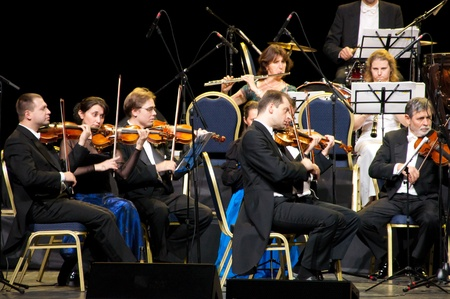a symphony: Violinists. Strauss Festival Orchestra Vienna in concert Crocus City Hall.  Moscow - November 17, 2010