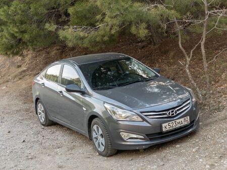 Sevastopol, Republic of Crimea - March 23, 2019: The car Hyundai Solaris is parked in nature. Giad Accent / Hyundai Avega / Hyundai Brio / Dodge Verna
