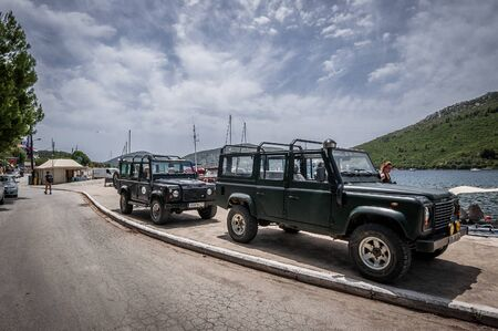 Sithonia, Chalkidiki, Greece - June 27, 2014: Offroad car Land Rover Defender 110 outdoors Editorial