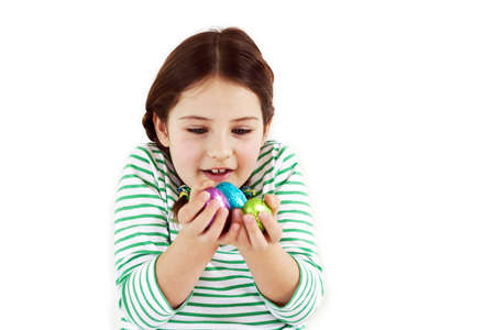 A little girl looking at her easter eggs with excitement Stock Photo - 8873921