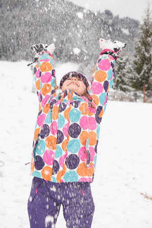 A girl playing in the snow