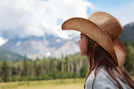 A cowgirl looking towards Mount Robson in the Canadian Rockies