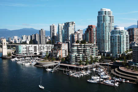 Downtown Vancouver with boats in the foreground photo