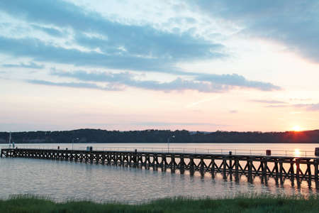 the setting sun: A pier with the setting sun Stock Photo