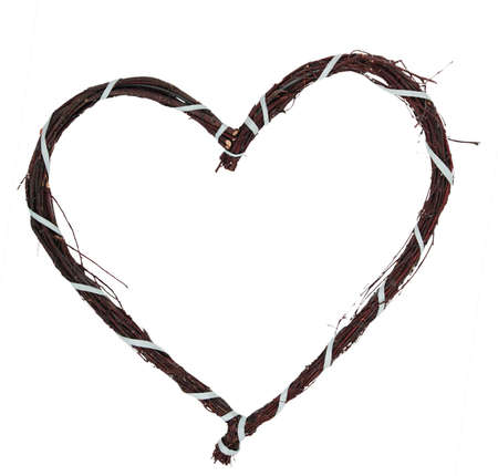 A love heart made of twigs, bound by a blue ribband Stock Photo