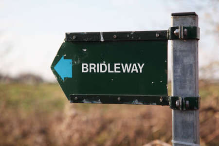 A rustic, damaged bridleway sign Stock Photo