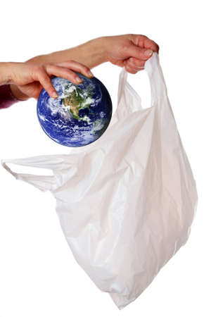 Concept image to illustrate the problem of sustainability, in particular with regards to plastic bags.  Earth image provided by Nasa.   photo