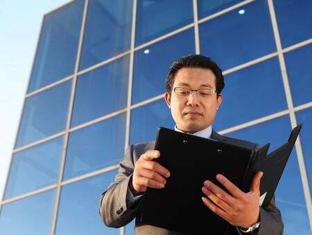 businessman checking file documents front office