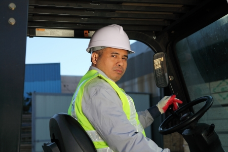 helmet seat: Workerman driver of a forklift Stock Photo