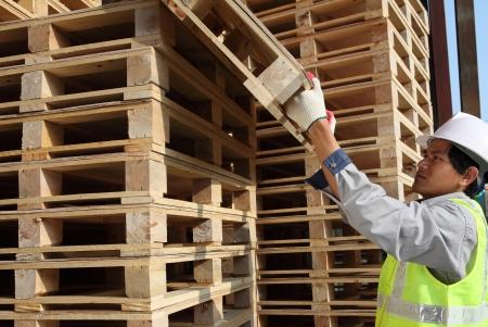 worker man arranging pallets Stock Photo - 14042655