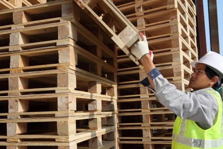 worker man arranging pallets