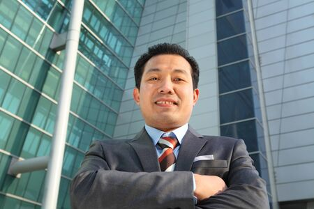 businessman front office modern building smiling photo