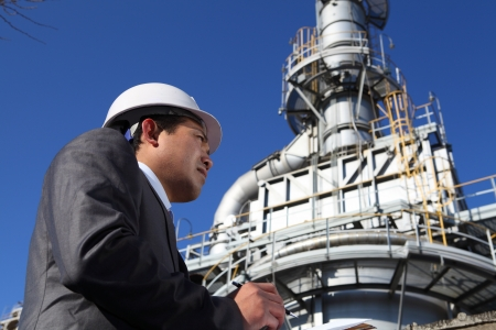 cooling towers: chemical contractor activity , write  under pipes and cooling towers Stock Photo