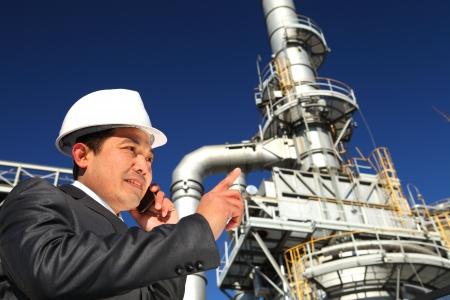 industrial engineer communicate via mobile phone