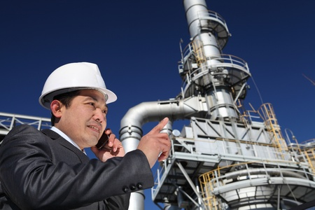 businessman calling under chemical plant tower with blue sky background Stock Photo - 15290532