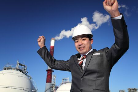 businees: happiness engineer industrial plant with blue sky background