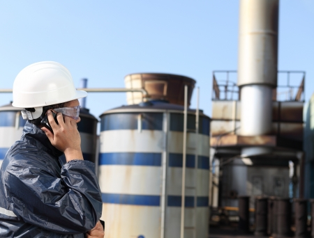 inspection: industrial engineer communicate via mobile phone  Stock Photo