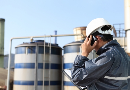 industrial engineer communicate via mobile phone  photo