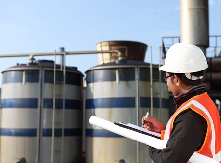 engineer write on noteboard with large industry background Standard-Bild