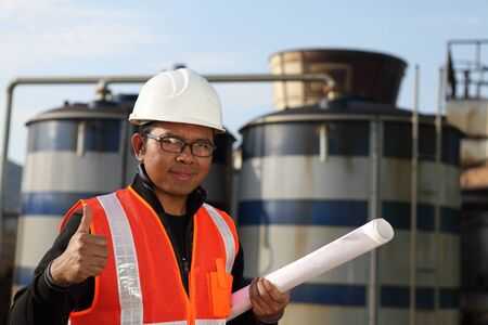 engineer standing in front of a large with blueprint on the hand Stock Photo - 16254303